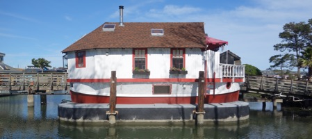 Remember the little old lady who lived in a shoe? This is the cutest houseboat in Sausilito, California