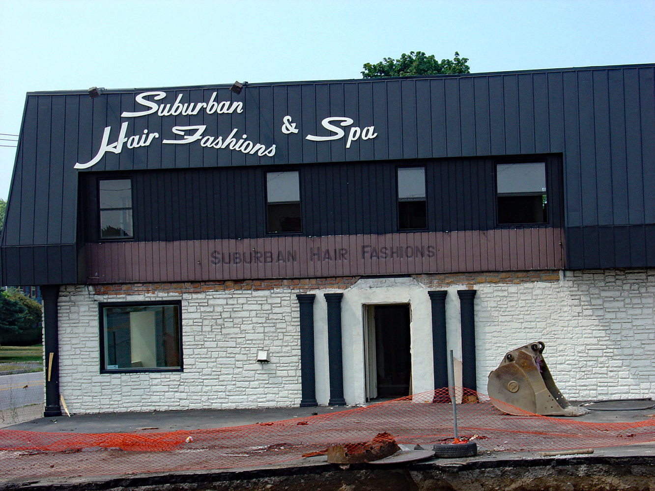 Suburban Hair at the corner of Culver and East Ridge Road in its final days