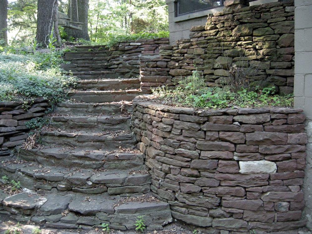 Stone wall behind 145