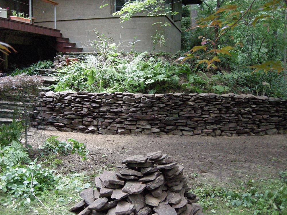 Rebuilt stone wall behind 145