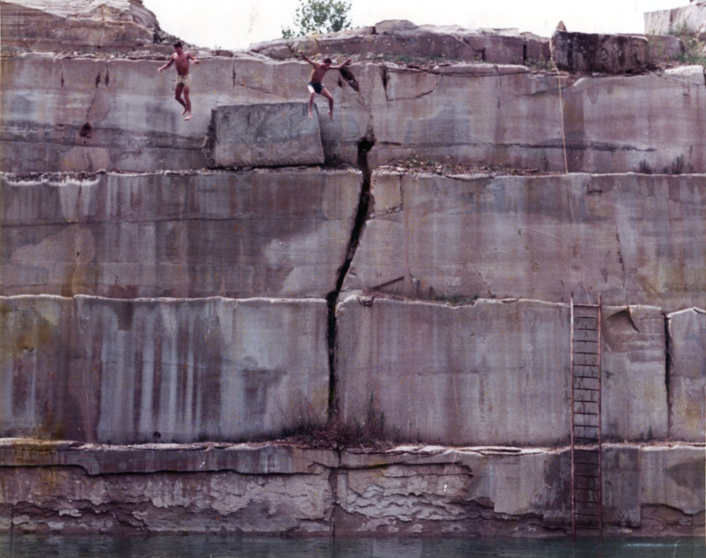 Paul and Fran Dodd jumping in a quarry in Bloomington Indiana