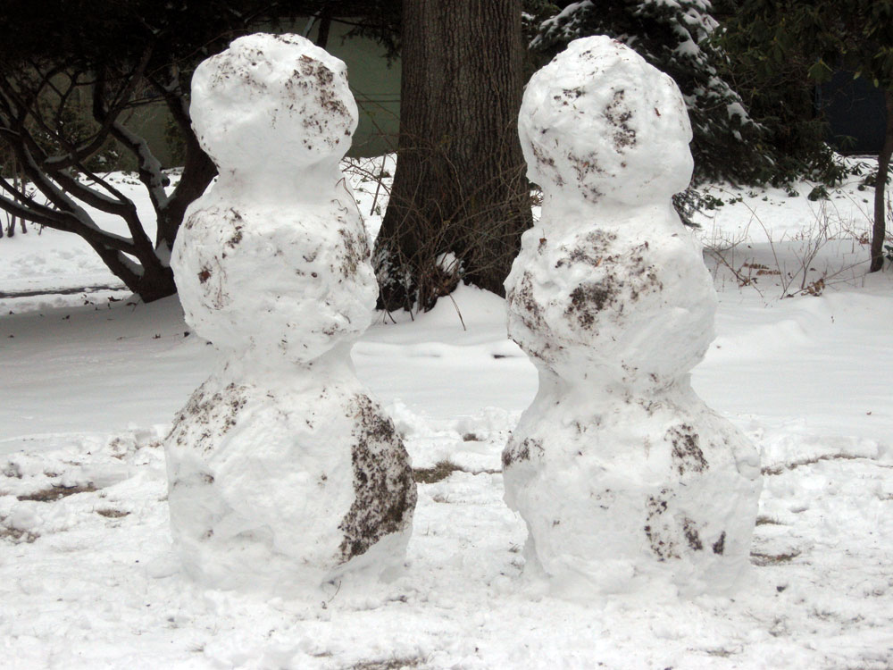 Snowmen in front of the house
