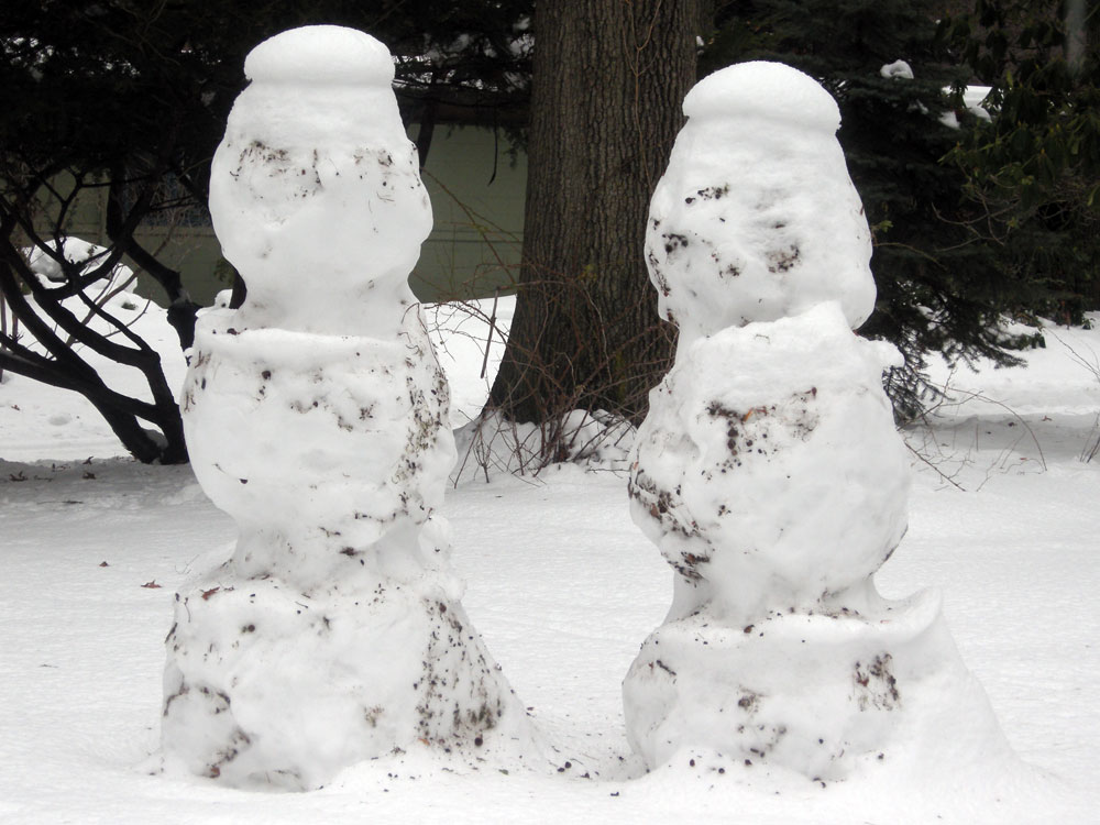 Snowmen with berets in our front yard