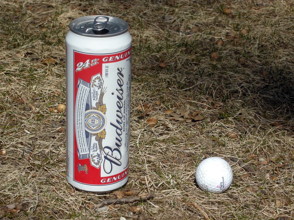 Budweiser can and golf ball