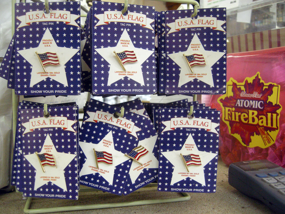 Flag pins and Fireballs on the counter at Aman's Market