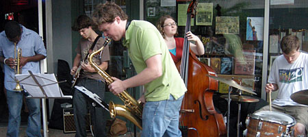Band performing on the street in front of Greenwood Books on East Avenue during the Rochester International Jazz Festival