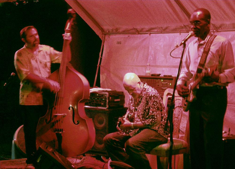 Brian Williams, John Mooney and Joe Beard performing live in a backyard in Brighton