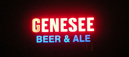 Genesee Beer Sign lit up over the Genesee River