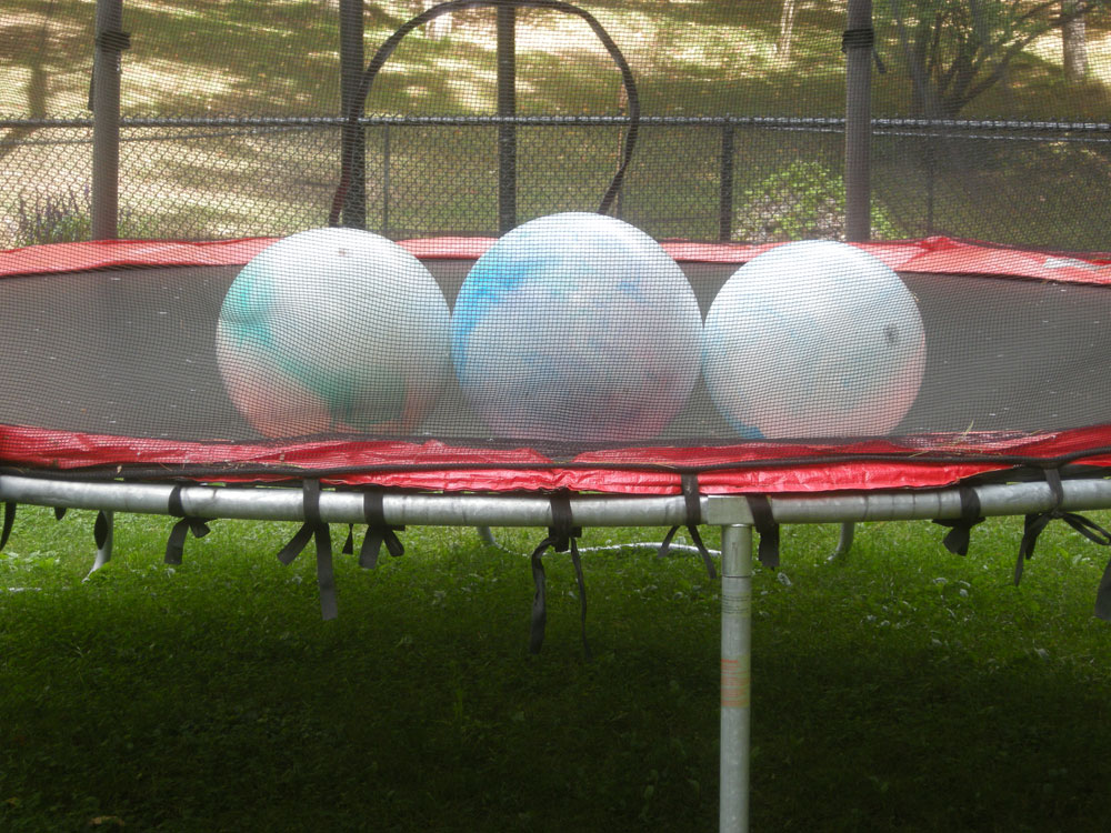 Three Balls On Trampoline