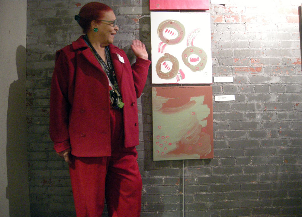 """Martian with her painting """"Memories of Home 2"""" at High Falls Gallery"""
