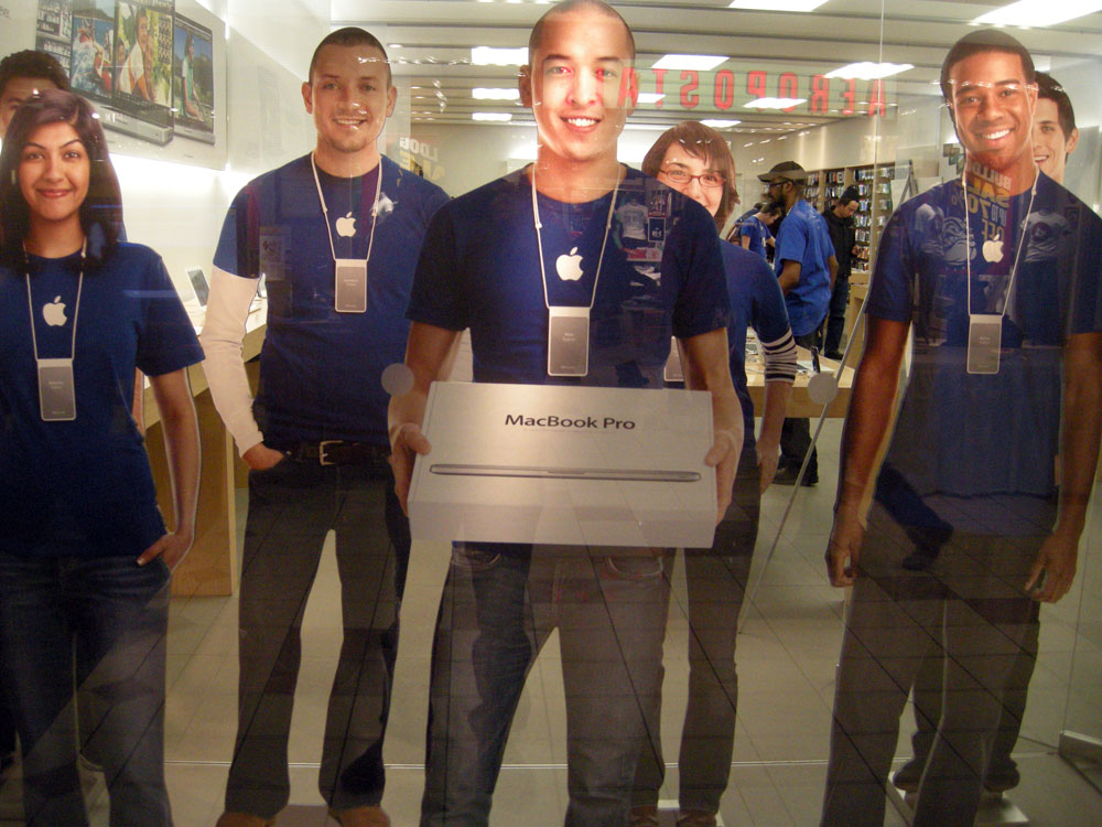 Apple Guys in the window of the Eastview Mall Store in Rochester, New York