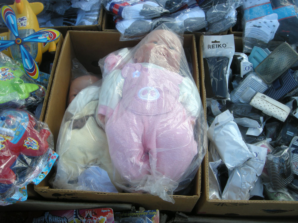 Baby in plastic bag at Public Market in Rochester, NY