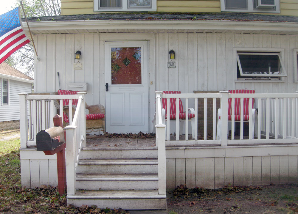 Porch with flag in Rochester, New York