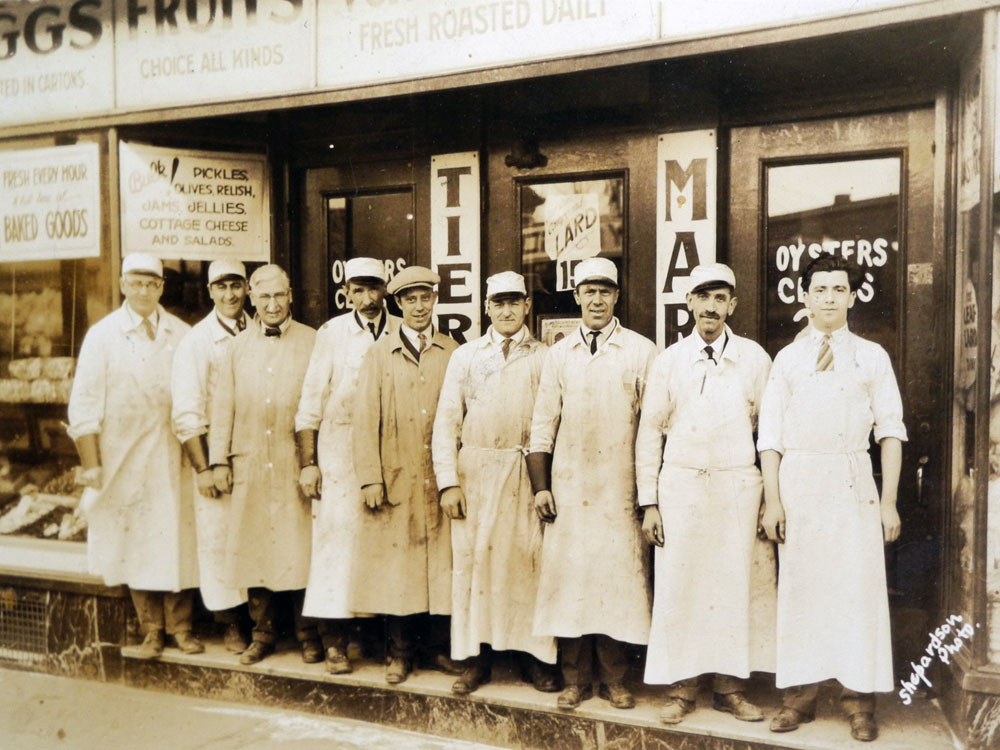 Ray Tierney Senior, far left, in front of his store on North Street in Rochester, NY