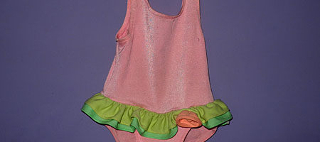 Little girl dance outfit on purple wall