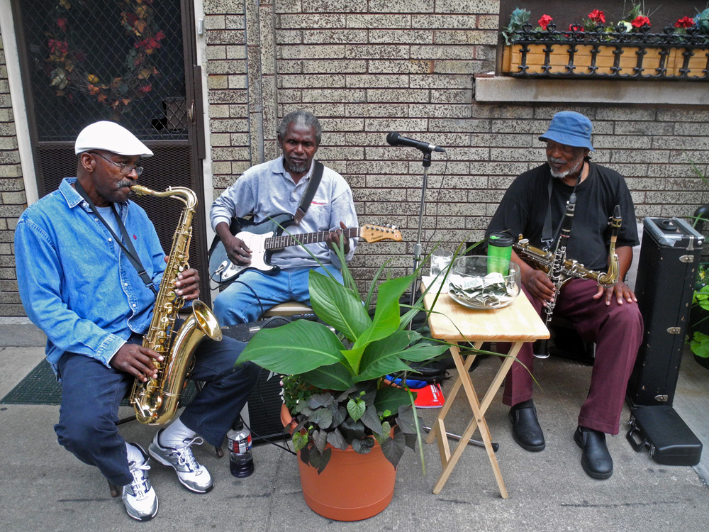 Street band in front of apartment building near Abilene in Rochester, New York