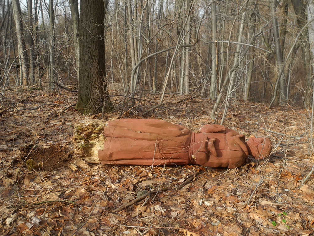 Fallen Saint Francis of Assisi statue near Durand Eastman park in Rochester, New York