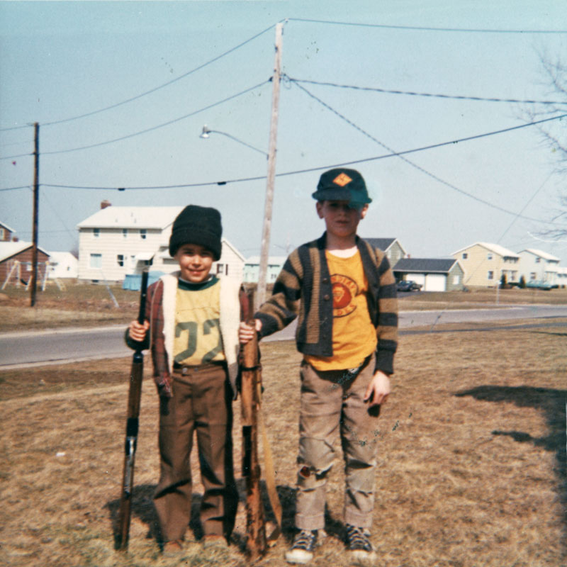 Paul Dodd photo of Tim Meisenzahl and John Mahoney with toy guns in front of the Dodd's house at 24 Hawley Drive in Webster, New York