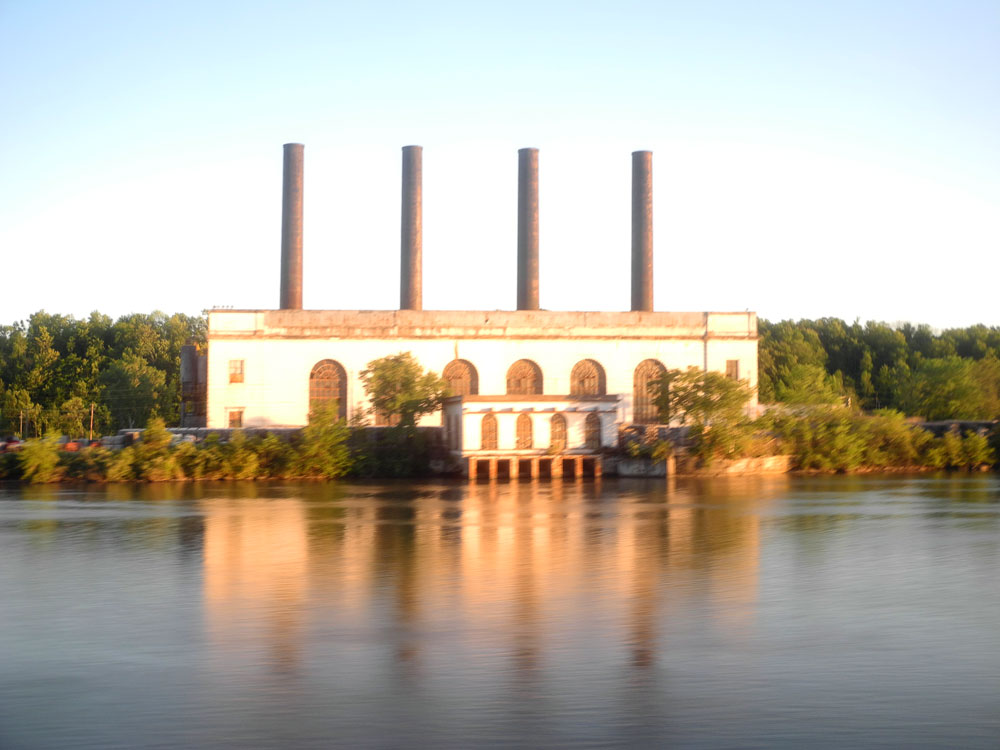 Building on Mohawk River shot from Amtrak train