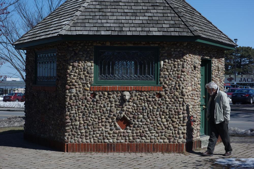Leo Dodd walks around Cobblestone smokehouse in Irondequoit