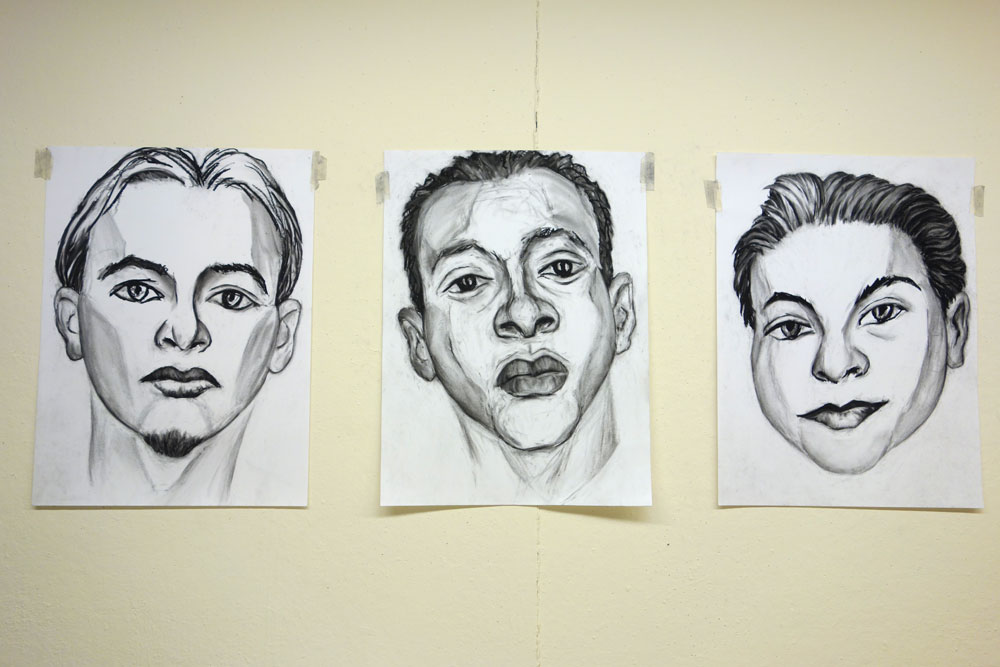 Three Paul Dodd drawings on wall at Creative Workshop in Rochester New York 2014