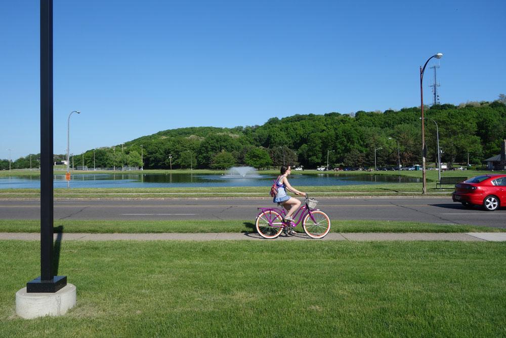 Bike rider near Cobbs Hill in Rochester, New york