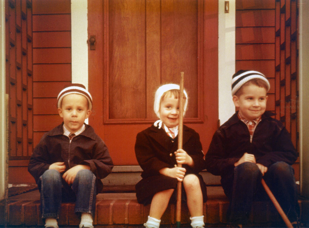 Mark, Ann and Paul Dodd on steps of 68 Brokfield Road house in Rochester, New York