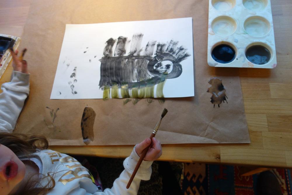 Lennon at art table in studio