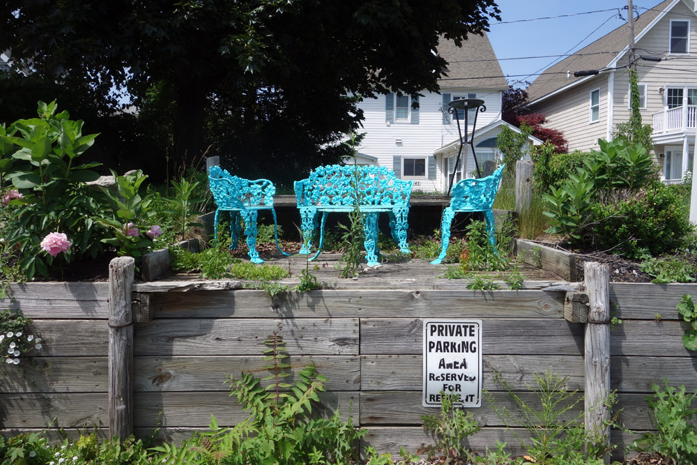 Blue wought iron chairs at lakeside, Rochester New York
