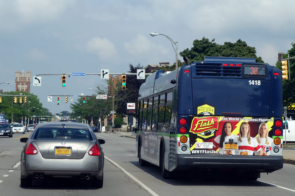 WNY Flash sign on back of bus in Rochester, New York with Jaelene Hinkle and Abby Dahlkemper