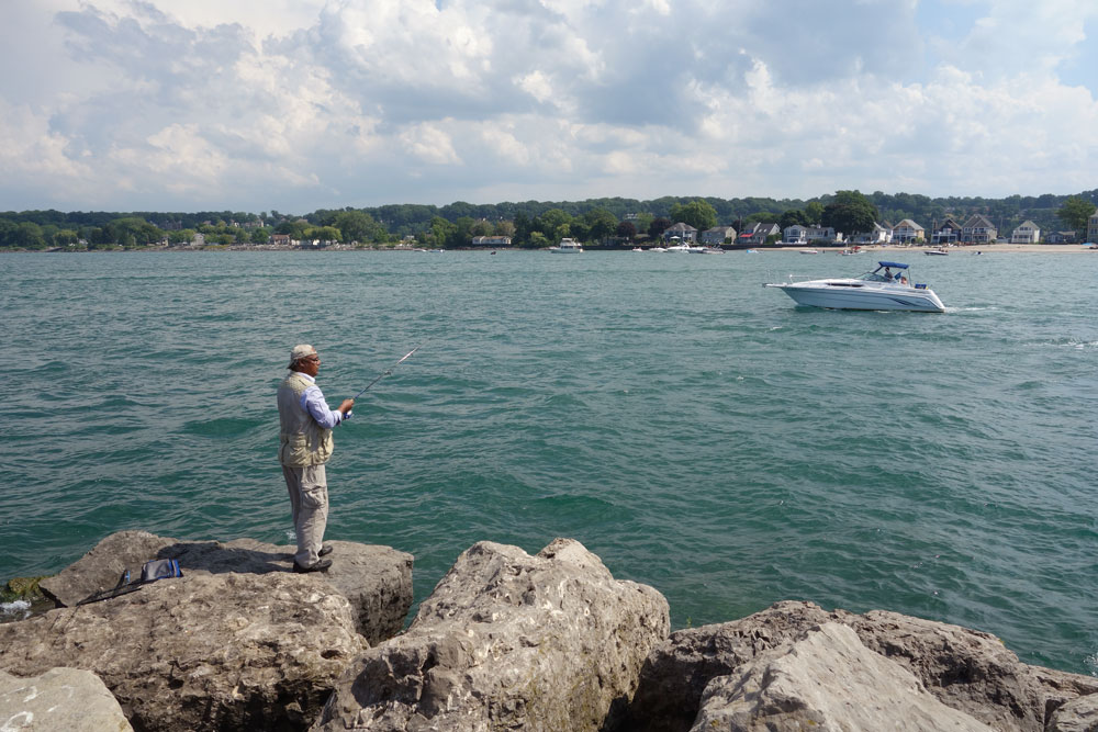 Fisherman on pier at Sea Breeze in Rochester, New York
