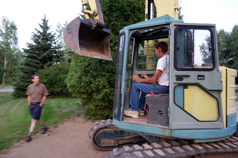 John and Fran Dodd with heavy equipment on Labor Day