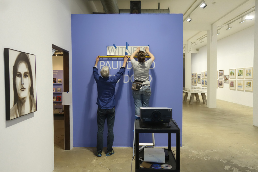 Bleu and Collen hanging title type for Witness show at RoCo