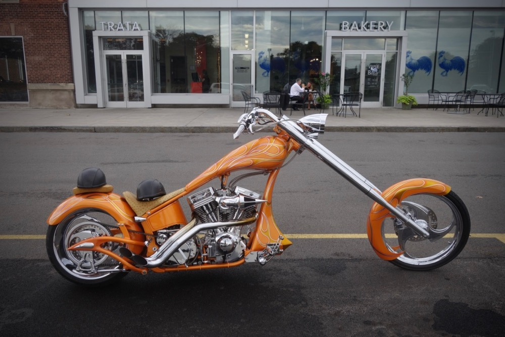 Orange motorcycle in front of Trata Restaurant in Rochester New York