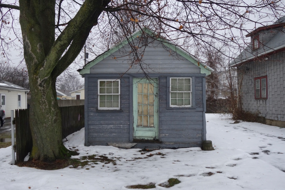 Blue house with green trim on Topper Drive in Sea Breeze NY