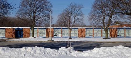 Eastridge High School in snow and sun