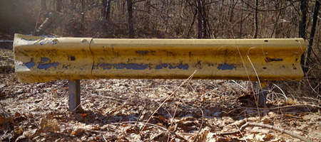 Old yellow guard rail in Durand Eastman Park
