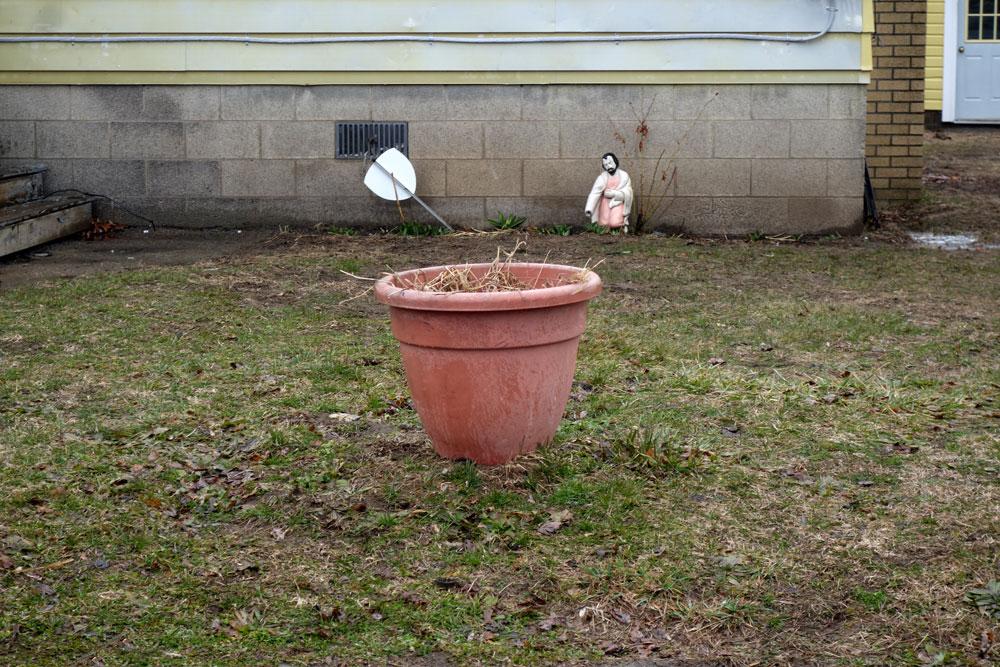 Broken statue in yard near Sea Breeze, New York