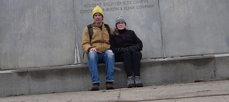 Paul and Peggi sitting on Veterans Memorial Bridge