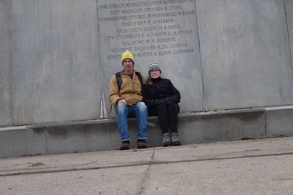 Paul and Peggi sitting on Veterans Memorial Bridge