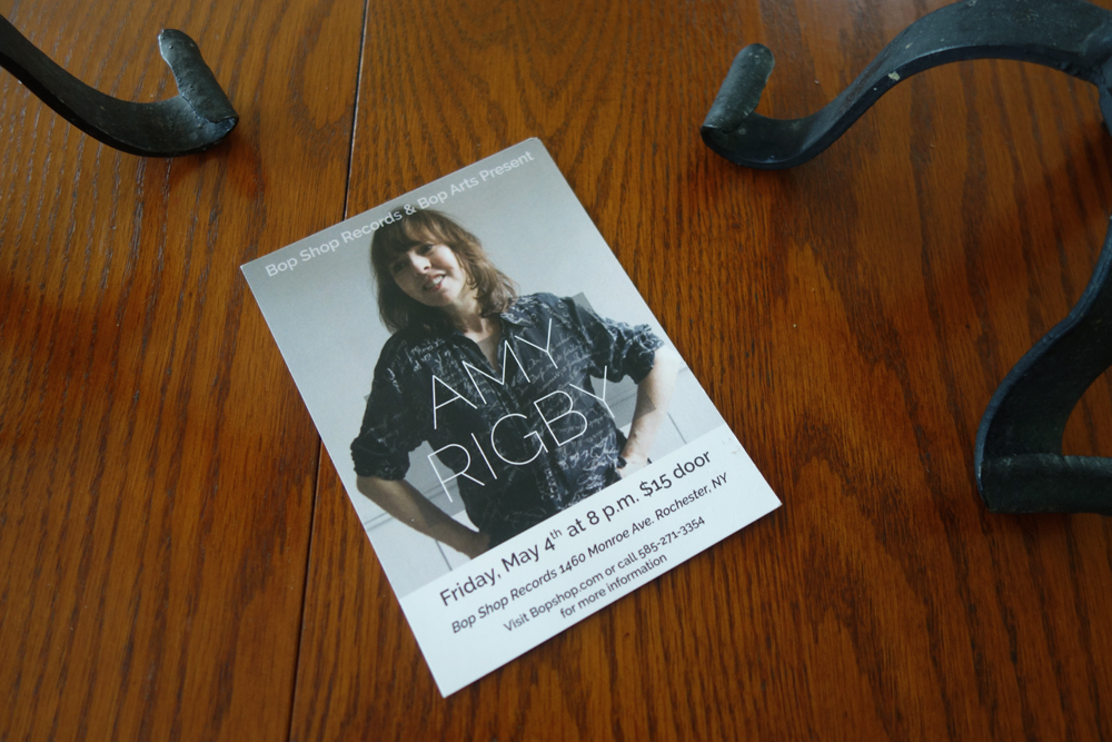 Amy Rigby holy card on table at home