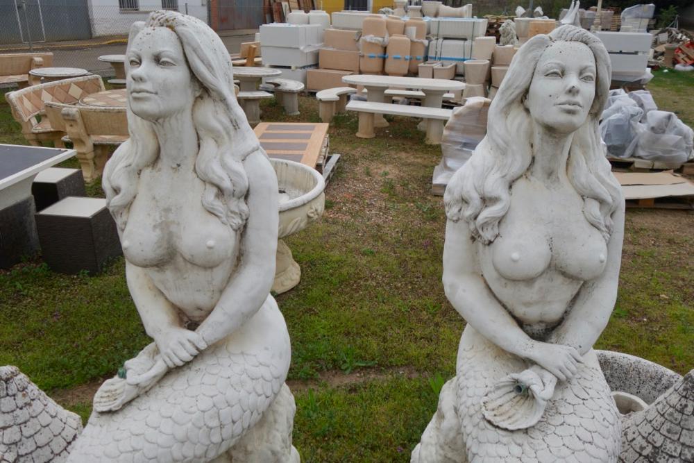 Mermaid statues in garden store outside Leon Spain