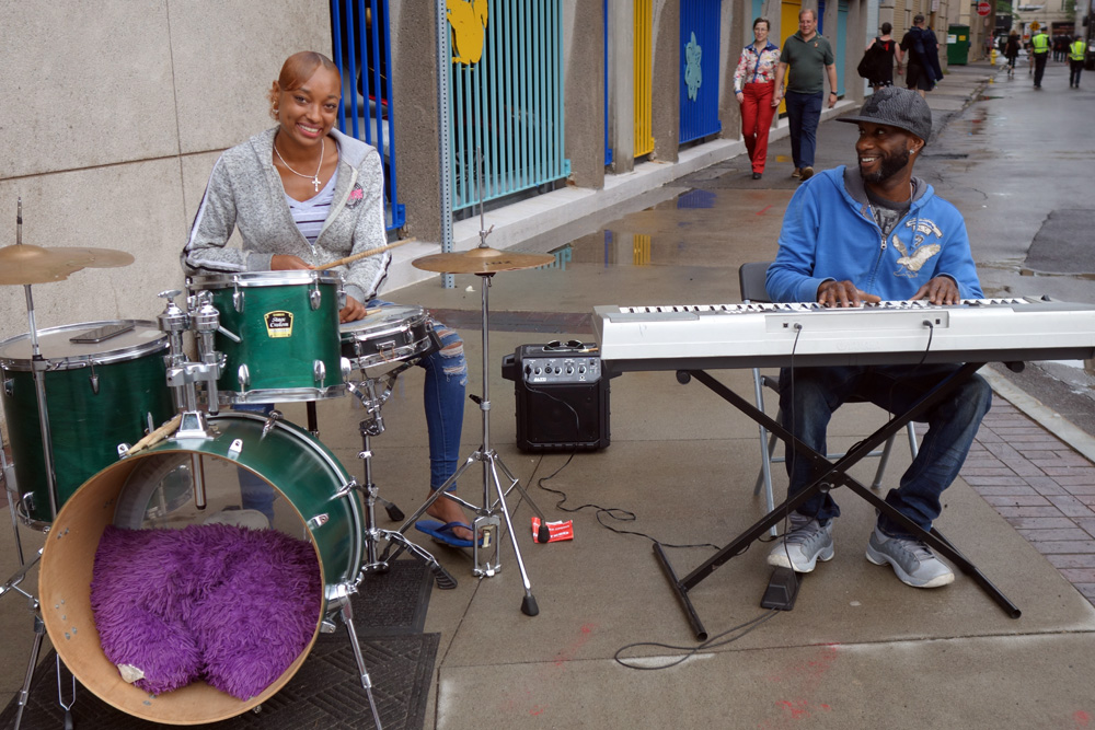 Drummer and keyboard player on East Main Street in Rochester, New York