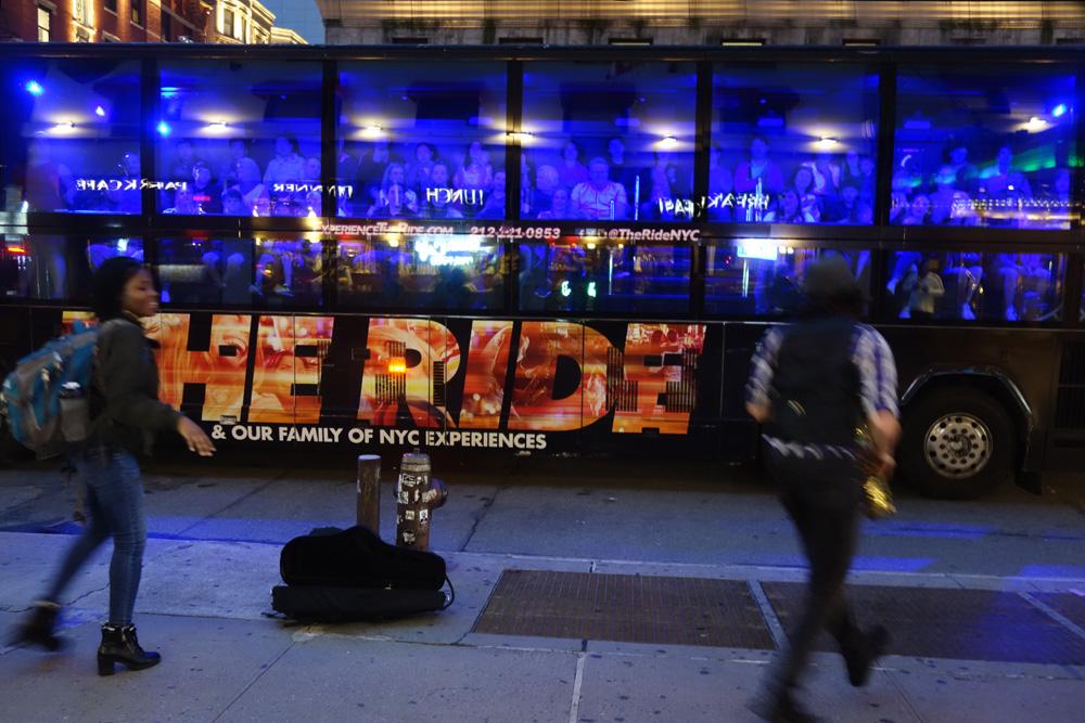 Sax Player entertaining bus passengers in Midtown Manhattan