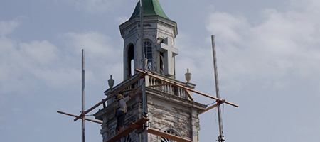 Woman painting steeple at Christ Church in Irondequoit