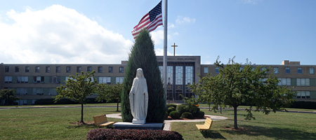Virgin Mary statue in front of Bishop Kearney High School on the first day of school 2018