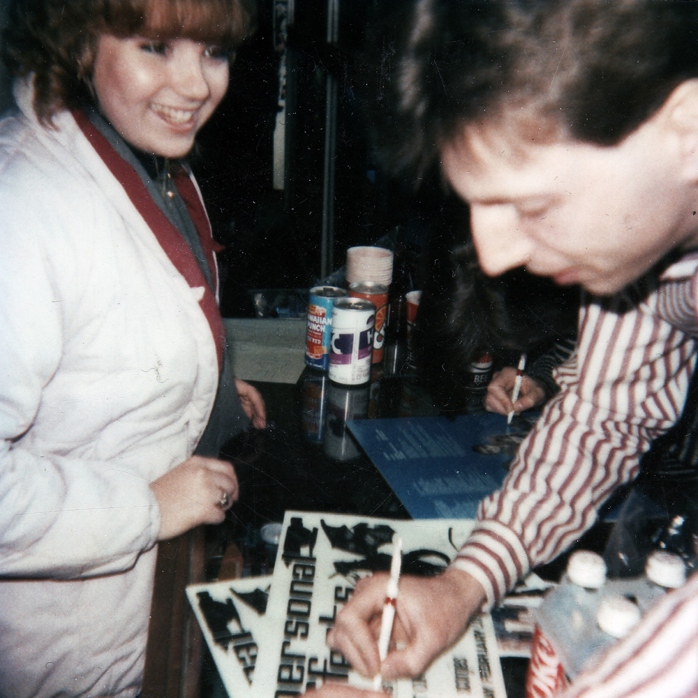 Bernie Heveron signing autograph for Sue Strawberry at House of Guitars in Rochester, New York.