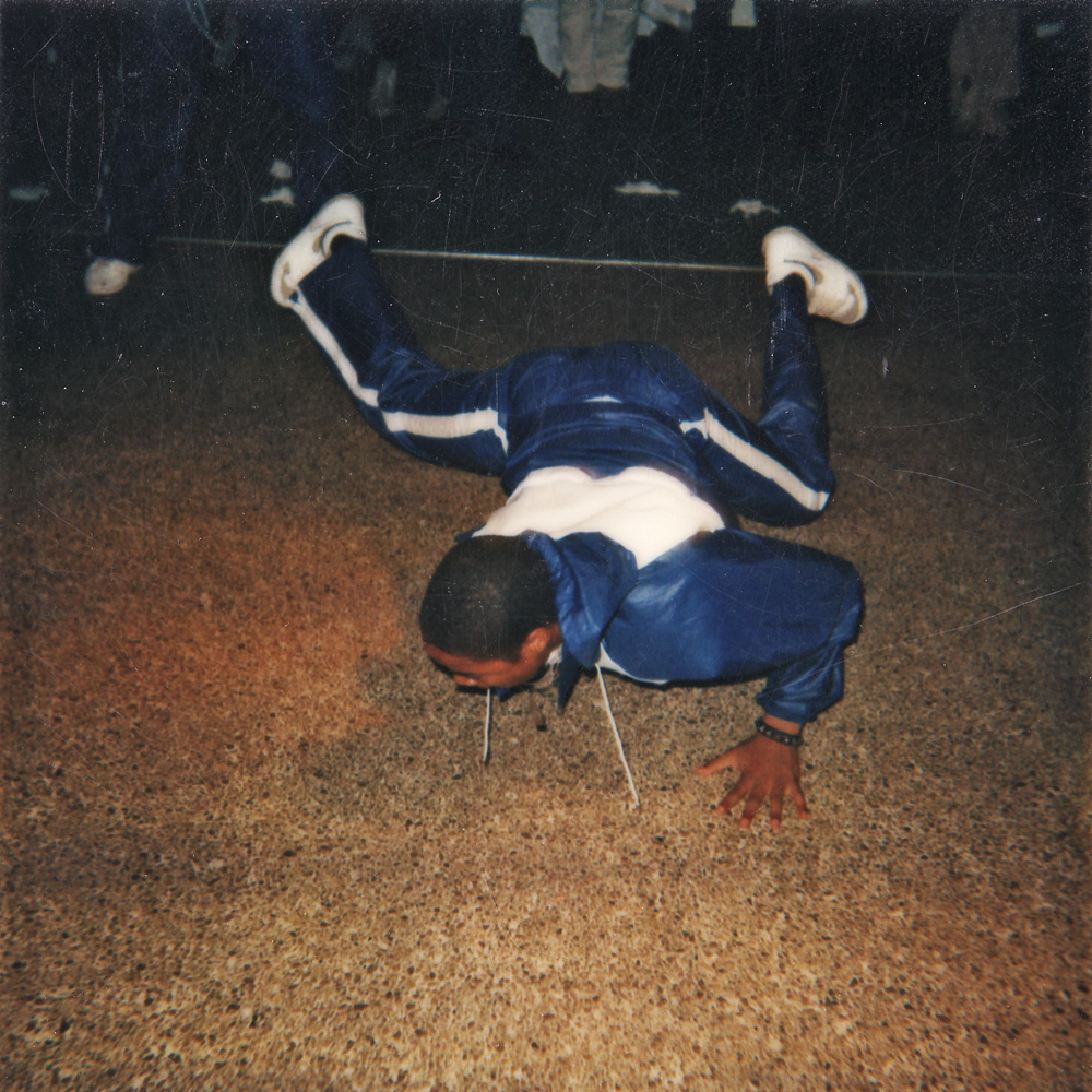 Break dancing at Personal Effects Top of the Plaza record release party.