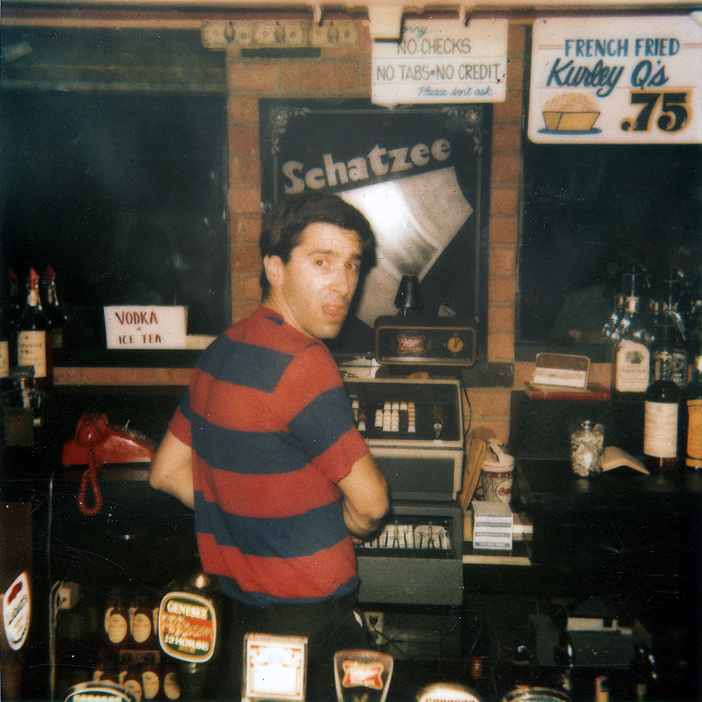 Danny Deutch behind the bar at Schatzees in Rochester, New York.