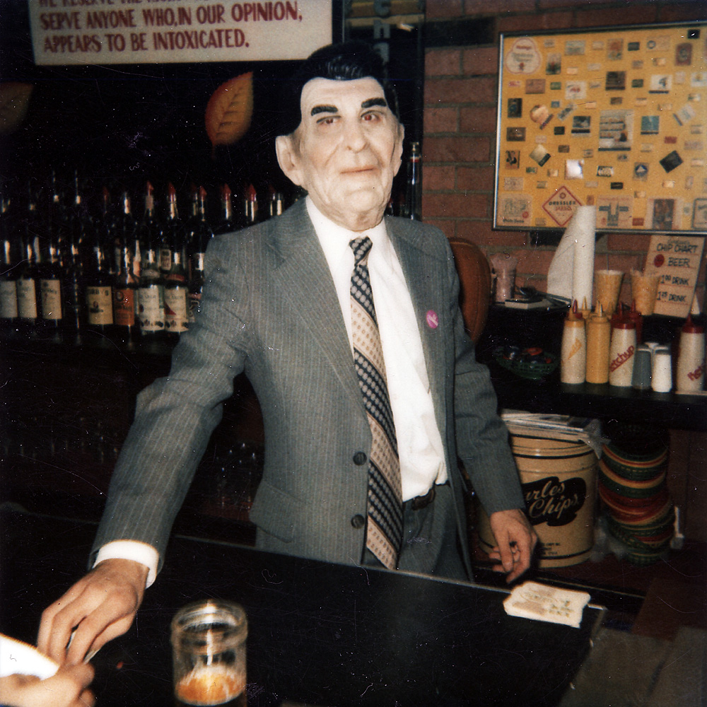 Danny Deutch in costume behind he bar at Schatzies.